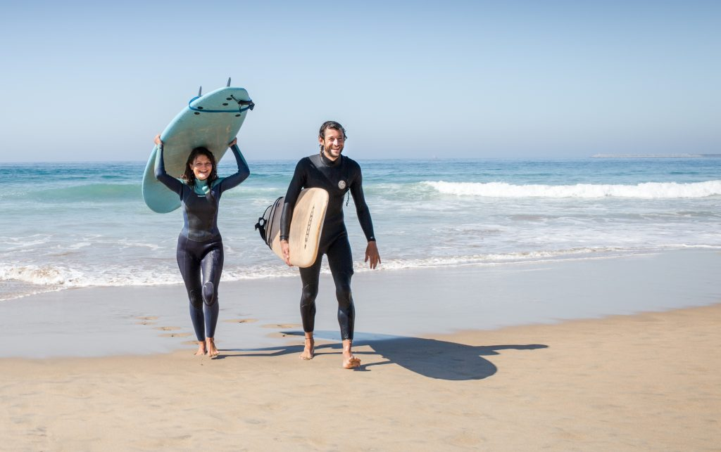 couple learning to surf
