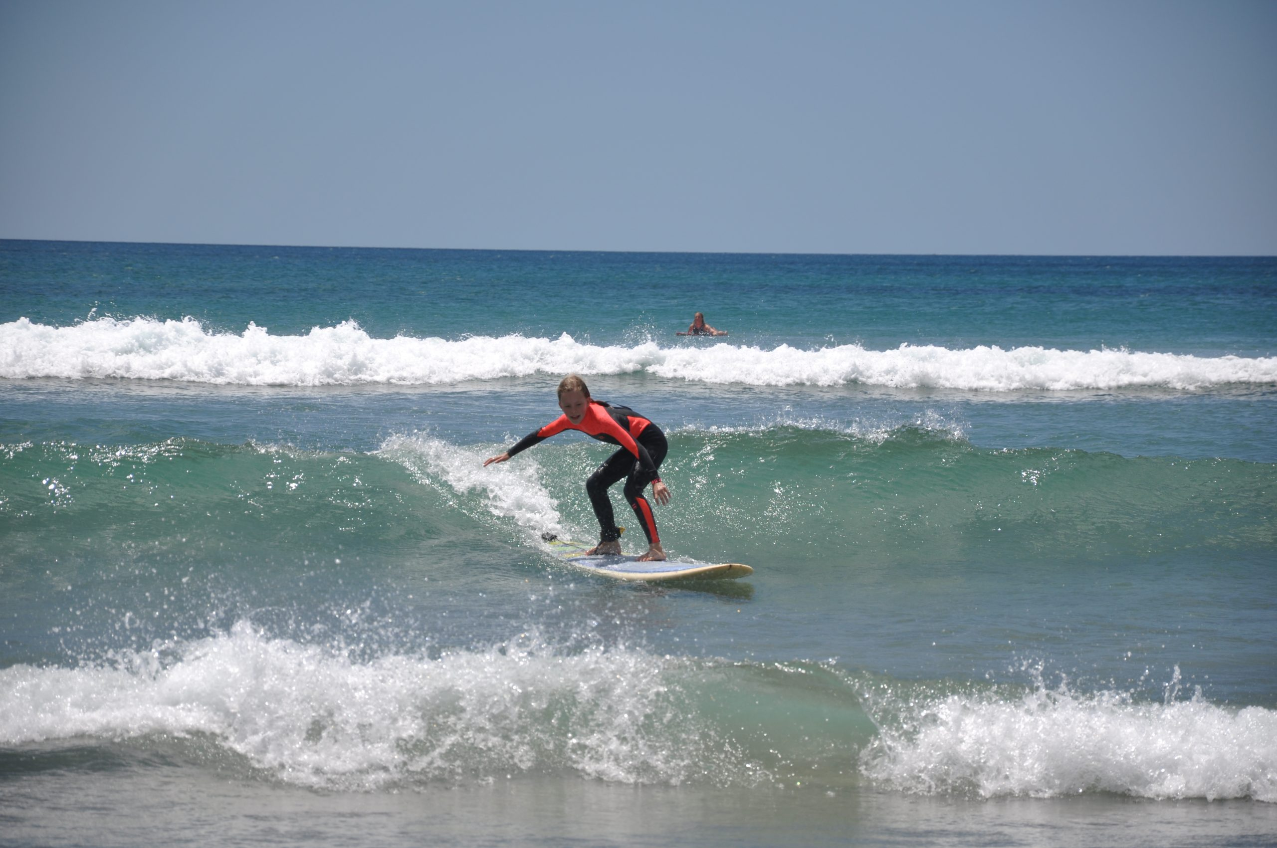 Young girl learning to surf